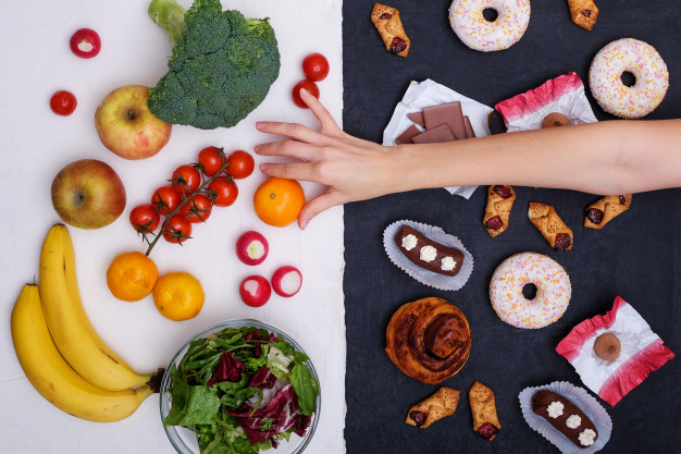 fruits-vegetables-vs-donuts-sweets-burgers_120794-159.jpg